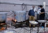توزیع غذای متبرک رضوی در مرزهای مهران و شلمچه